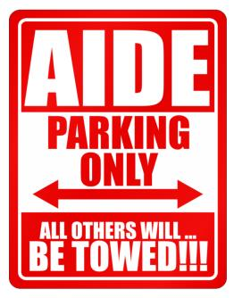 Aide Parking Only - All Others Will Be Towed Parking Sign