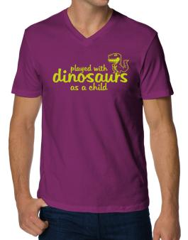 Polo Cuello V de Played with dinosaurs as a child